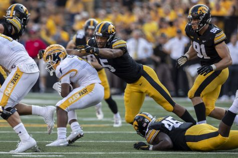 Iowa linebacker Jestin Jacobs makes a tackle during a football game between Iowa and Kent State at Kinnick Stadium on Saturday, Sept. 18, 2021. The Hawkeyes defeated the Golden Flashes with a score of 30-7. (Grace Smith/The Daily Iowan)