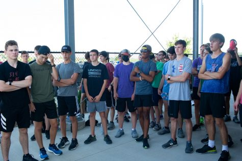 Liberty High Schools Cross Country team listens to their coaches before practice at Liberty High School in North Liberty, Iowa on August 30th, 2021. Liberty High School Cross Country is ranked in the top 5 in Iowa in class 4A. (Cole Krutzfield/The Daily Iowan)