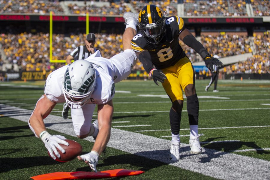 Iowa defensive back Matt Hankins forces Colorado State tight end Trey McBride out of bounds during a football game between Iowa and Colorado State at Kinnick Stadium on Saturday, Sept. 25, 2021. The Hawkeyes defeated the Rams 24-14. (Jerod Ringwald/The Daily Iowan)