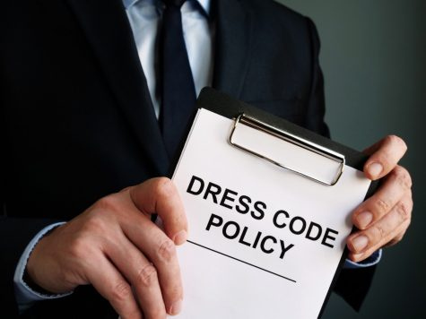 Manager is holding Dress code policy.