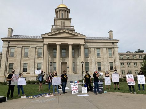 Members of COGS protest the lack of mask mandates on campus.