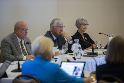 Board of Regents Office member Mark Braun, President Michael Richards, and President Pro Tem Sherry Bates listen to a speaker during the state of Iowa Board of Regents meeting in Reiman Ballroom at the Alumni Center in Ames, Iowa, on Thursday, Sept. 16, 2021. (Grace Smith/The Daily Iowan)