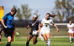 University of Iowa Defender Riley Whitaker and Mississippi State Forward Hailey Farrington-Bentil both chase the ball up the sideline at UI Soccer Complex on Sunday, Sept. 5, 2021. The Iowa Hawkeyes and Mississippi State Bulldogs tied 1-1.