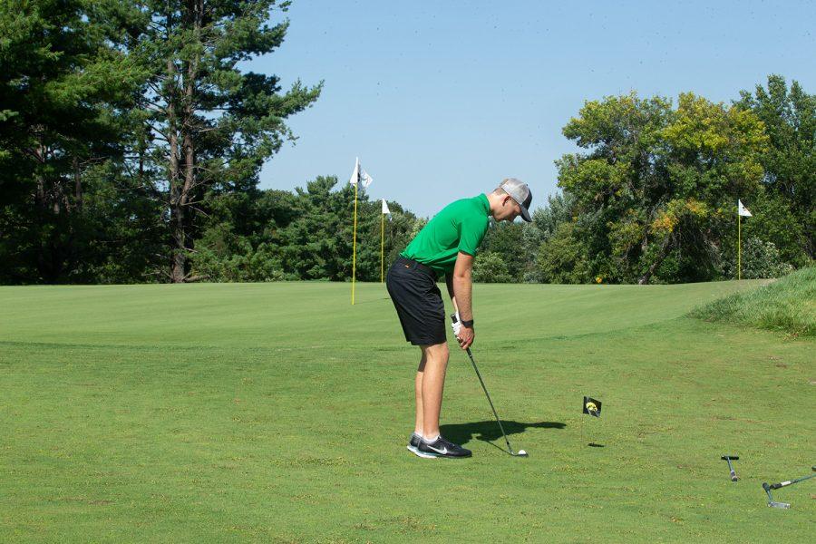 Junior Ronan Kleu lines up for a shot during an Iowa Men's Golf Practice at Hoak Family Golf Complex in Iowa City on Thursday Sept. 16, 2021.