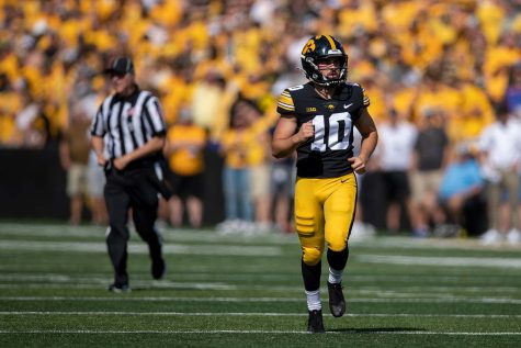 Caleb Shudak runs on to the field goal during a football game between Iowa and Kent State at Kinnick Stadium on Saturday, Sept. 18, 2021. The Hawkeyes defeated the Golden Flashes 30-7.