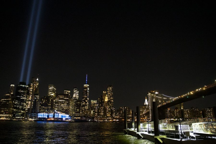 The New York City skyline and the 9/11 'Tribute in Light' are seen at the Brooklyn Bridge Park on Saturday, Sept. 11, 2021, the 20th anniversary of the 9/11 attacks.