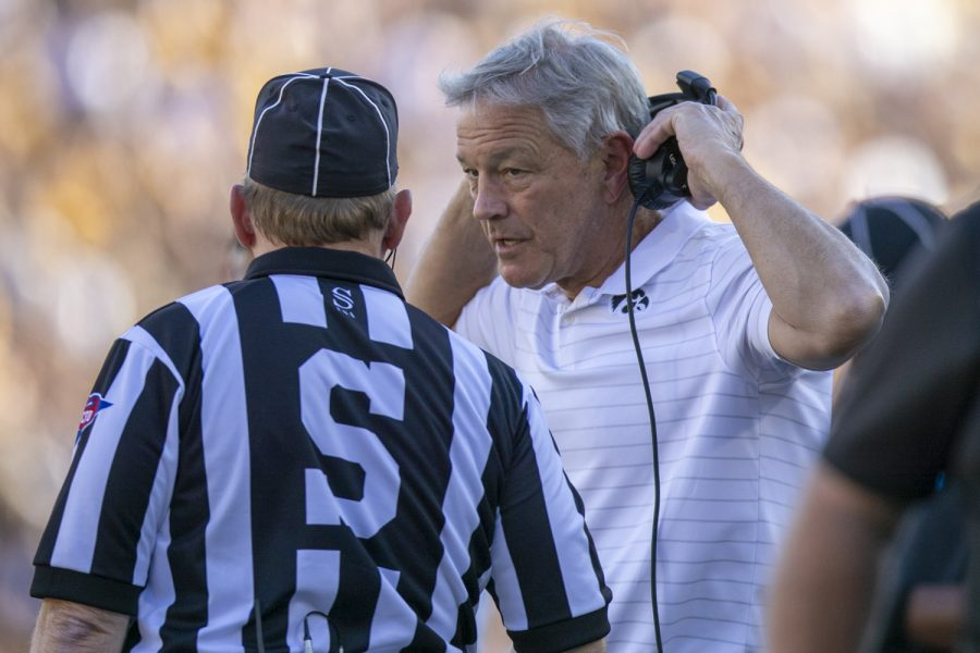 Iowa head coach Kirk Ferentz talks with an official during a football game between Iowa and Colorado State at Kinnick Stadium on Saturday, Sept. 25, 2021. The Hawkeyes defeated the Rams 24-14.