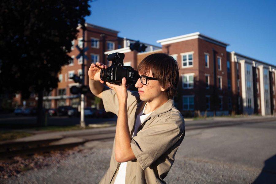Jared+Bobi+Knox+shoots+a+picture+near+the+railroad+tracks+of+Iowa+City+on+Saturday%2C+Sept.+27%2C+2021.+