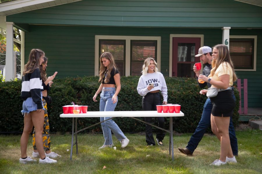 A group of Hawkeyes play beer pong prior to a football game between No. 5 Iowa and Colorado State on Saturday, Sept. 25, 2021.