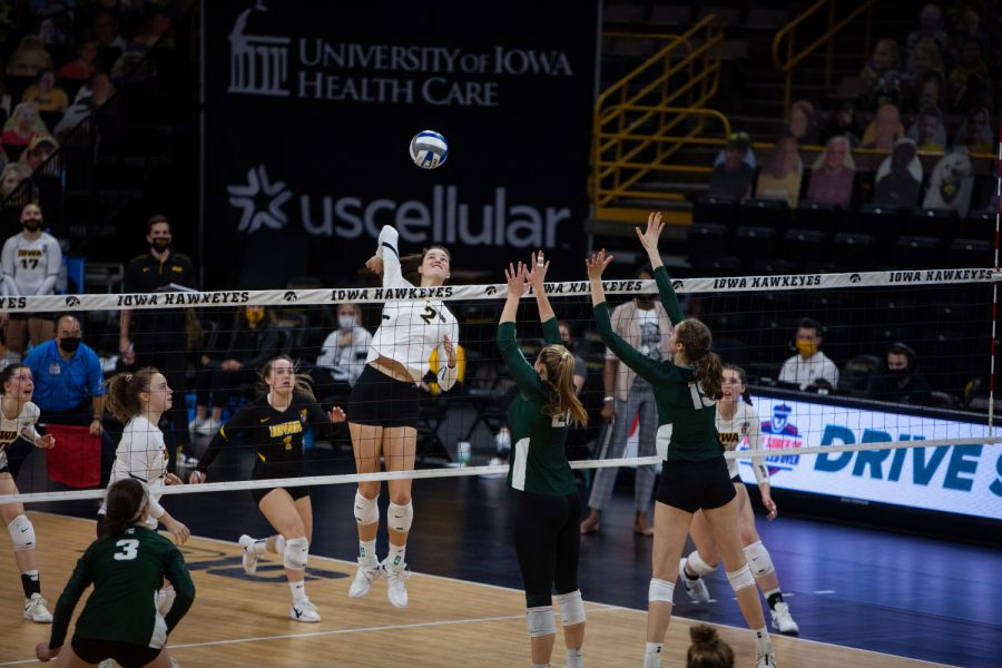 Iowa outside hitter, Courtney Buzzerio, prepares to spike the ball during the volleyball match between Iowa and Michigan State on Friday, March 26 at Carver-Hawkeye Arena. The Spartans beat the Hawkeyes 3-1.