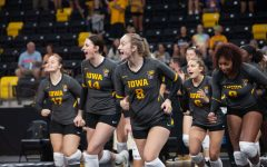 Iowa volleyball players run onto the court to celebrate their first win of the season as Iowa defeated Iowa State 3-0 at Xtream arena in Coralville on September 11 2021.