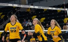 Outside hitter Addie VanderWeide, middle blocker Hannah Clayton and setter Bailey Ortega gets ready for a high ball near the net at the Xtreme Arena on Thursday, Sept. 9, 2021. Syracuse goes on to defeat Iowa 3-1.