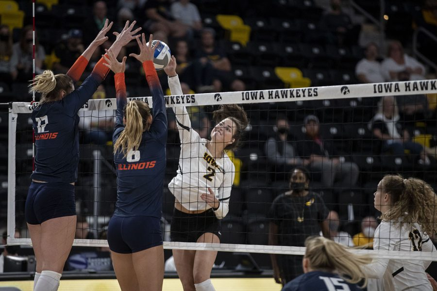 Iowa right side Courtney Buzzerio spikes the ball during a volleyball game between Iowa and Illinois at Xtreme Arena in Coralville, Iowa, on Wednesday, Sept. 22, 2021. The Fighting Illini defeated the Hawkeyes with a score of 3-2. (Grace Smith/The Daily Iowan)