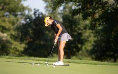 Paula Miranda practices her putt at Finkbine Golf Course on Thursday, Sept. 16, 2021. (Gabby Drees/The Daily Iowan)