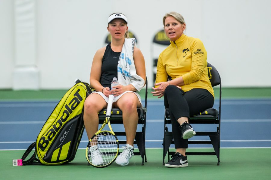 Iowa head coach Sasha Schmid (right) talks with Danielle Burich during a womens tennis match between Iowa and Nebraska at the HTRC on Saturday, April 13, 2019. The Hawkeyes, celebrating senior day, fell to the Cornhuskers, 4-2.