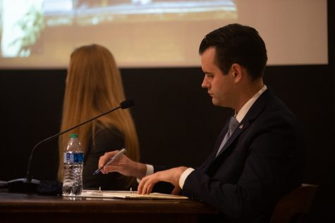 Iowa state Senator Zach Wahls takes notes during a discussion series on Free Speech and Social Media hosted by the state Board of Regents, the University of Iowa Public Policy Center, and the UI College of Law on Tuesday, Sept. 21, 2021.