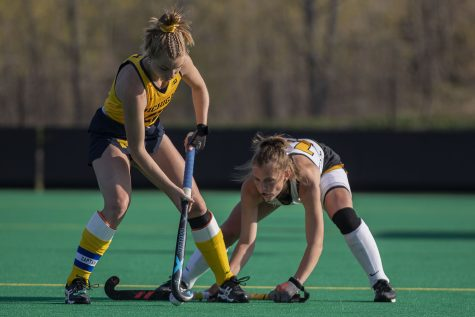 Iowa forward Leah Zellner blocks Michigan fullback Halle ONeil during the fourth quarter of the Big Ten field hockey tournament semifinals between No. 5 Iowa and No. 1 Michigan on Thursday, April 22, 2021 at Grant Field. With five minutes left of the game, Iowa pulled their goalkeeper to replace the position with another player on offense. The Hawkeyes were defeated by the Wolverines, 0-2. Michigan will go on to play against No. 7 Ohio State in the championships on Saturday.