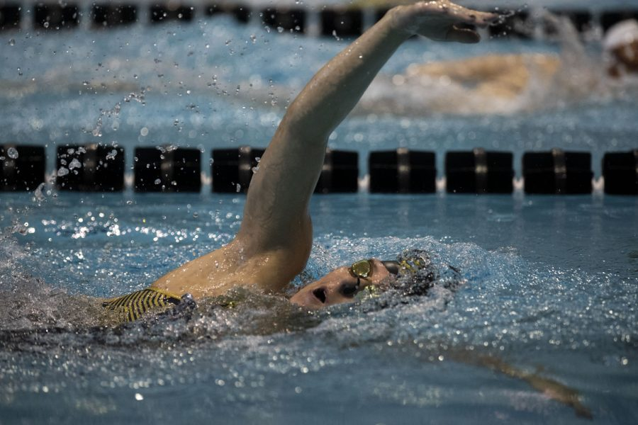 Iowa backstroke swimmer Kennedy Gilbertson competes during a swim meet between Iowa and Minnesota at the Campus Recreation and Wellness Center on Friday Oct. 8, 2021. The Gophers defeated The Hawkeyes 156-104.