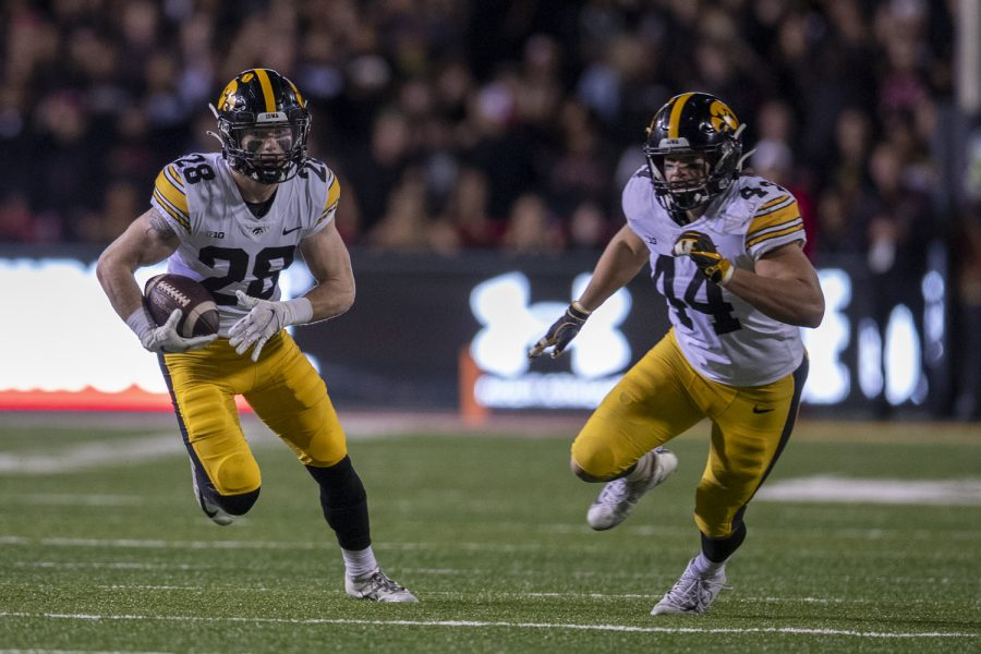 Iowa defensive back Jack Koerner runs after intercepting a pass during a football game between Iowa and Maryland at Maryland Stadium on Friday, Oct. 1, 2021. (Jerod Ringwald/The Daily Iowan)