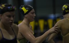 Iowa swimmer Anna Brooker wishes a teammate good luck during a meet against the University of Northern Iowa  at the Campus Recreation and Wellness Center on Friday, Oct. 1, 2021. The Panthers defeated the Hawkeyes 159-133.
