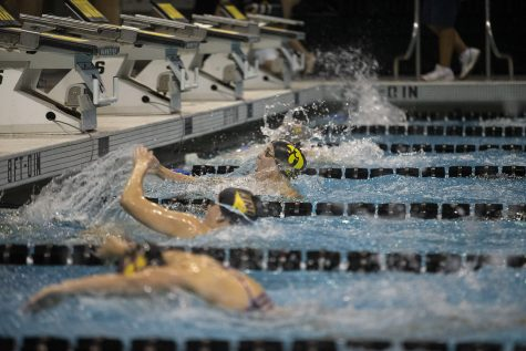 Iowa's Zoe Pawloski finishes the 100 yard butterfly against the University of Northern Iowa at the Campus Recreation and Wellness Center on Friday, Oct. 1, 2021. Pawloski finished fifth with a time of 1:04.73. The Panthers defeated the Hawkeyes 159-133.