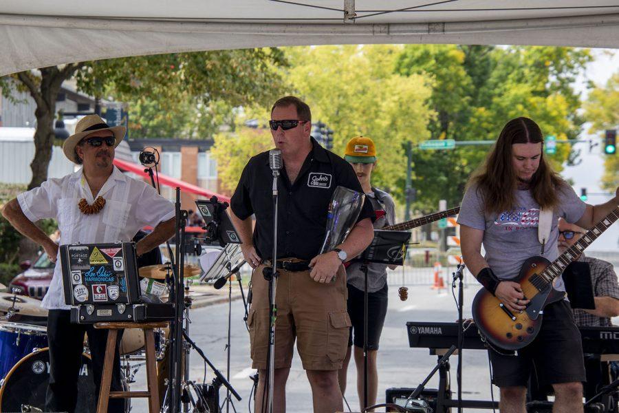 Doug Alberhasky introduces Homebrewed - Iowa City based blues, rockabilly band at the 25th BrewFest/6th Annual Northside Oktoberfest on Saturday, Oct. 2, 2021.(Jeff Sigmund/Daily Iowan)
