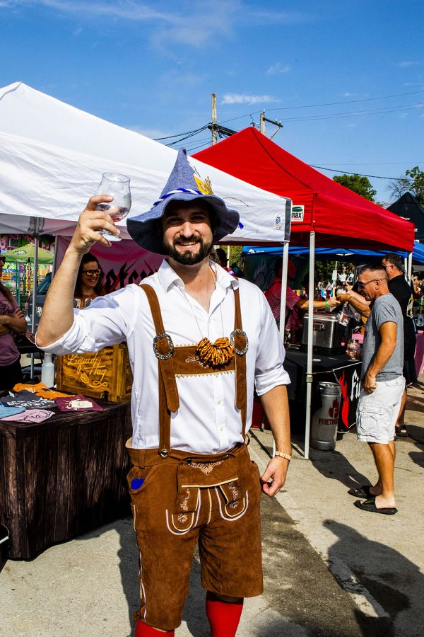 Eric Eigenfeld stops for a picture at the 25th BrewFest/6th Annual Northside Oktoberfest on Saturday, Oct. 2, 2021.(Jeff Sigmund/Daily Iowan)