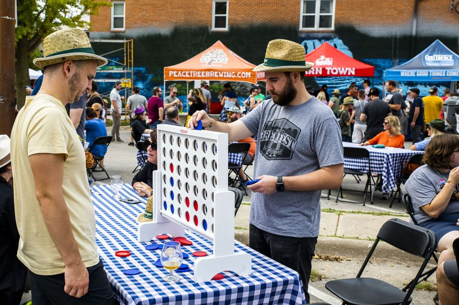 Playing connect four at the 25th BrewFest/6th Annual Northside Oktoberfest on Saturday, Oct. 2, 2021.(Jeff Sigmund/Daily Iowan)