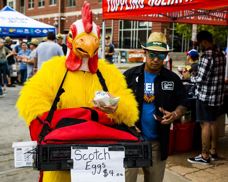 The Chicken selling Scotch eggs at the 25th BrewFest/6th Annual Northside Oktoberfest on Saturday, Oct. 2, 2021.(Jeff Sigmund/Daily Iowan)