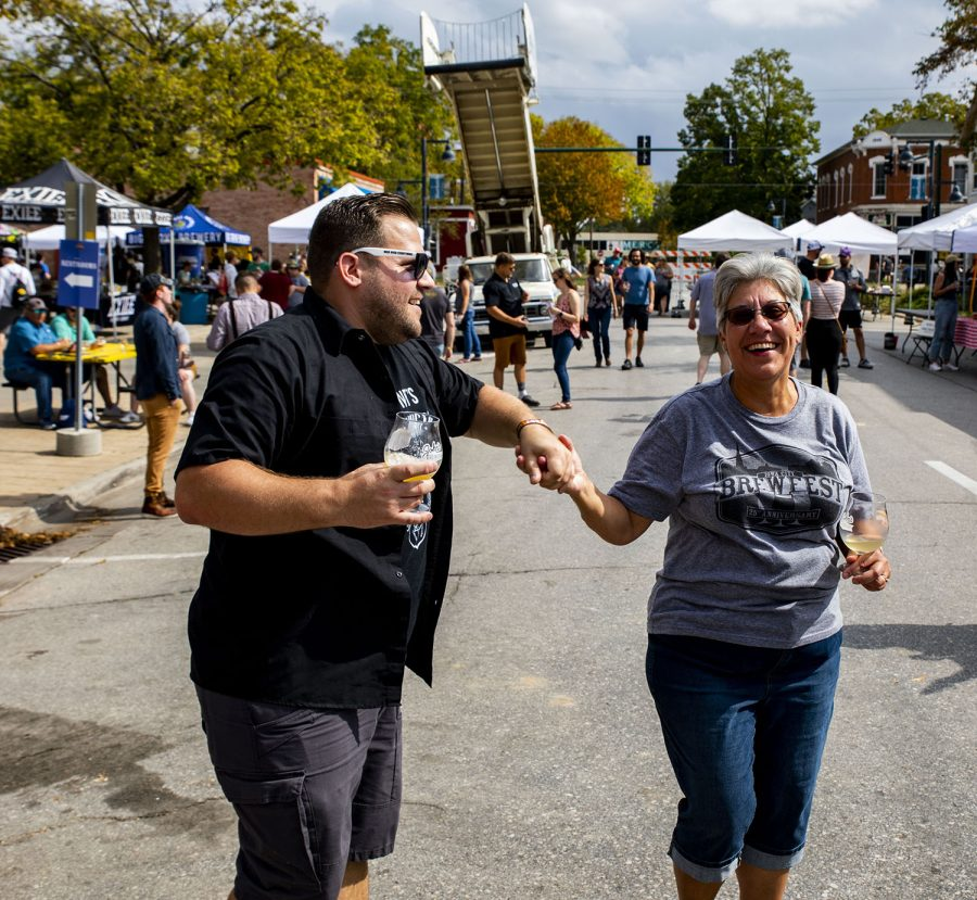 Eric Klemundt and his mother Eileen Klemundt dance to the music at the 25th BrewFest/6th Annual Northside Oktoberfest on Saturday, Oct. 2, 2021. They are both from Chicago and this is their first time to the event.(Jeff Sigmund/Daily Iowan)