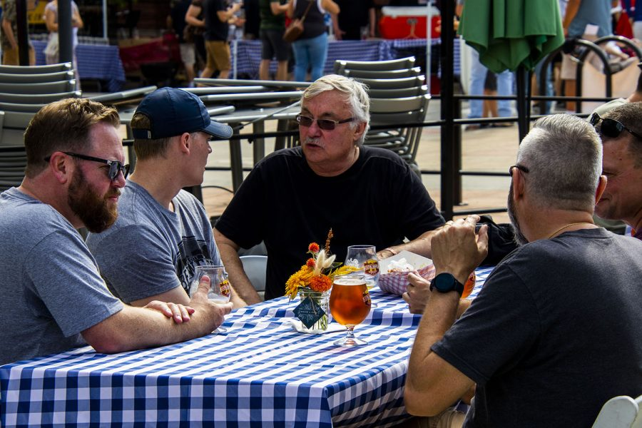 Friends taking a break at the 25th BrewFest/6th Annual Northside Oktoberfest on Saturday, Oct. 2, 2021.(Jeff Sigmund/Daily Iowan)