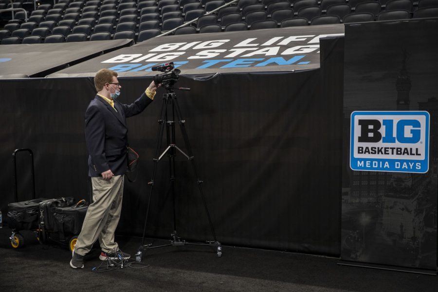 A reporter puts a lens cap on their camera after day two of Big Ten Basketball Media Days at Gainbridge Fieldhouse in Indianapolis, Indiana, on Thursday, Oct. 7, 2021.