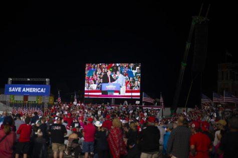 Former President Donald Trump greets Sen. Chuck Grassley, R-Iowa, after endorsing the senator on Saturday night.