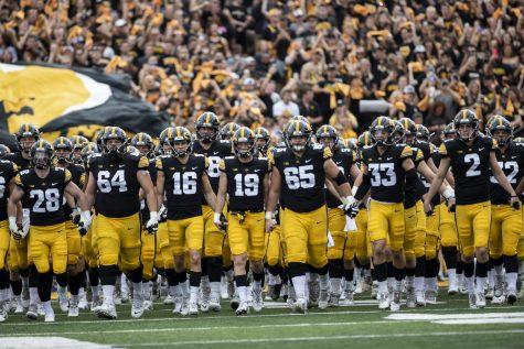 Iowa walks onto the field before a football game between No. 3 Iowa and No. 4 Penn State at Kinnick Stadium on Saturday, Oct. 9, 2021. The Hawkeyes defeated the Nittany Lions 23-20. (Grace Smith/The Daily Iowan)