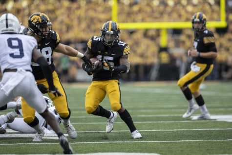 Iowa running back Tyler Goodson runs the ball during a football game between No. 3 Iowa and No. 4 Penn State at Kinnick Stadium on Saturday, Oct. 9, 2021. The Hawkeyes defeated the Nittany Lions 23-20. (Grace Smith/The Daily Iowan)