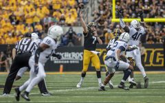 Iowa quarterback Spencer Petras passes the ball during a football game between No. 3 Iowa and No. 4 Penn State at Kinnick Stadium on Saturday, Oct. 9, 2021. The Hawkeyes defeated the Nittany Lions 23-20. (Grace Smith/The Daily Iowan)