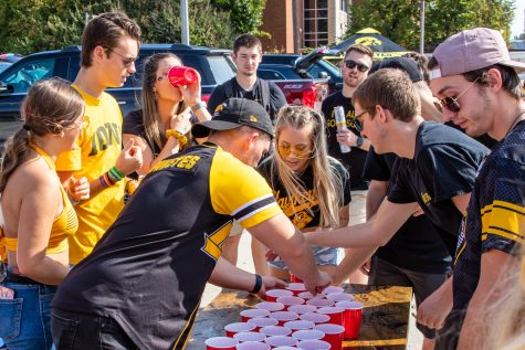 Iowa Hawkeye fan set up a drinking game while tailgating before a football game between Iowa and Penn State at the Library Lot on Saturday, Oct. 9, 2021.