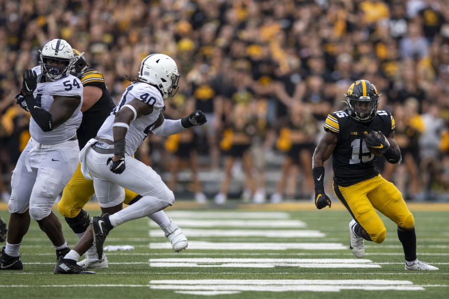 Iowa running back Tyler Goodson finds a hole during a football game between No. 3 Iowa and No. 4 Penn State at Kinnick Stadium on Saturday, Oct. 9, 2021. The Hawkeyes defeated the Nittany Lions 23-20. (Jerod Ringwald/The Daily Iowan)