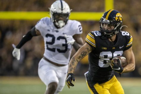 Iowa wide receiver Nico Ragaini runs downfield after catching a pass during a football game between No. 3 Iowa and No. 4 Penn State at Kinnick Stadium on Saturday, Oct. 9, 2021. The Hawkeyes defeated the Nittany Lions 23-20. (Jerod Ringwald/The Daily Iowan)