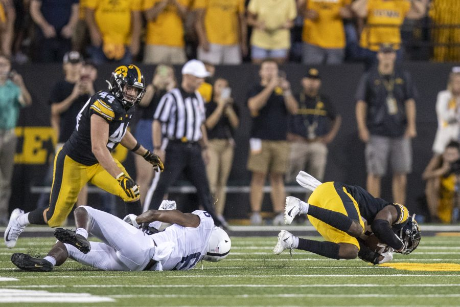 Iowa+defensive+back+Matt+Hankins+intercepts+a+pass+during+a+football+game+between+No.+3+Iowa+and+No.+4+Penn+State+at+Kinnick+Stadium+on+Saturday%2C+Oct.+9%2C+2021.+The+Hawkeyes+defeated+the+Nittany+Lions+23-20.+%28Jerod+Ringwald%2FThe+Daily+Iowan%29