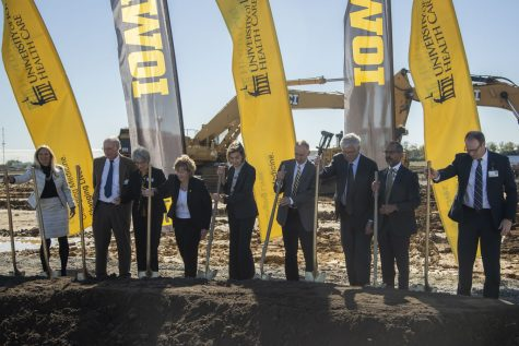 Iowa Governor Kim Reynolds, University of Iowa President Barbara Wilson, CEO of the University of Iowa Hospitals and Clinics Suresh Gunasekaran, Board of Regents President Mike Richards, and others break ground with shovels during a groundbreaking ceremony at the North Liberty University of Iowa hospitals and clinics construction site on Thursday, Oct. 14, 2021.