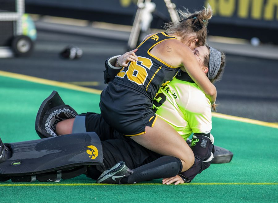 Iowa forward/midfielder Maddy Murphy celebrates with Iowa goalkeeper Grace McGuire at the end of the field hockey game between No.1 Iowa and No. 2 Michigan on Friday, Oct. 15, 2021, at Grant Field. The Hawkeyes defeated the Wolverines 2-1 in double overtime and a shootout.