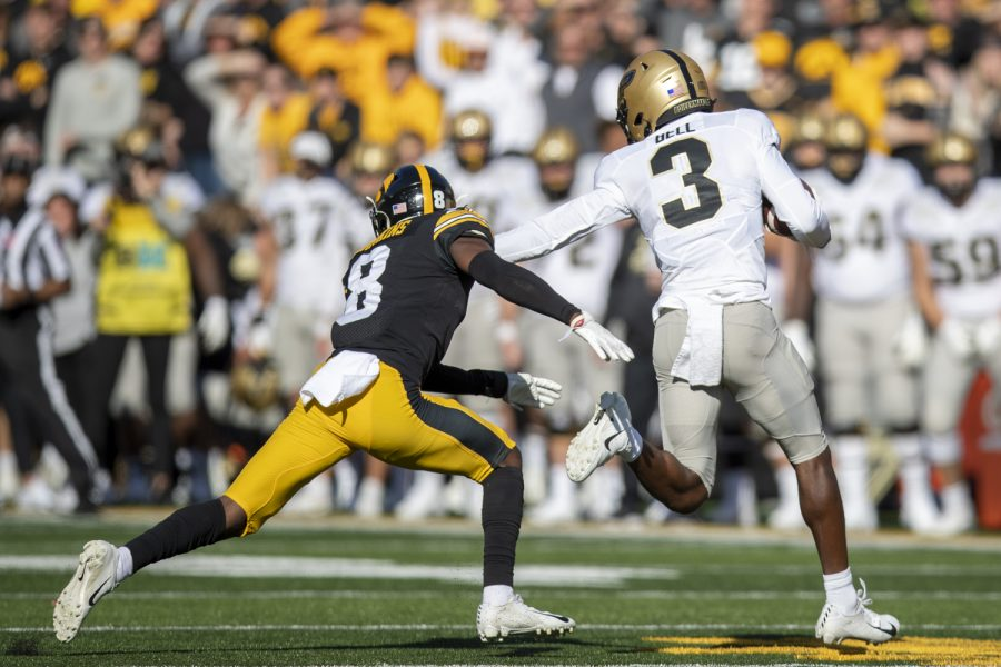 Purdue wide receiver David Bell breaks a tackle from Iowa defensive back Matt Hankins during a football game between Iowa and Purdue at Kinnick Stadium on Saturday, Oct. 16, 2021. (Jerod Ringwald/The Daily Iowan)