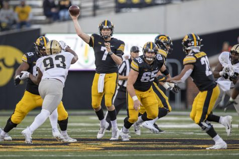 Iowa quarterback Spencer Petras winds up to pass during a football game between No. 2 Iowa and Purdue at Kinnick Stadium on Saturday, Oct. 16, 2021. The Boilermakers defeated the Hawkeyes 24-7. (Jerod Ringwald/The Daily Iowan)