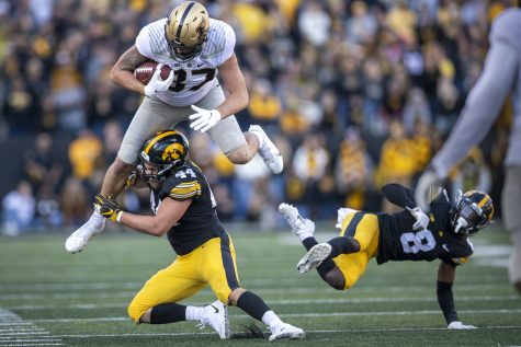 Purdue tight end Payne Durham comes down after hurdling Iowa defensive back Matt Hankins during a football game between No. 2 Iowa and Purdue at Kinnick Stadium on Saturday, Oct. 16, 2021. The Boilermakers defeated the Hawkeyes 24-7. Durham had 15 yards on five receptions.