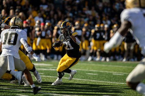 Iowa running back Ivory Kelly-Martin carries the ball during a football game between No. 2 Iowa and Purdue at Kinnick Stadium on Saturday, Oct. 16, 2021. The Boilermakers defeated the Hawkeyes 24-7. Kelly-Martin had six rushes for 23 yards and a touchdown.