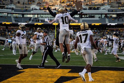 Purdue safety Cam Allen celebrates with a coach after a football game between No. 2 Iowa and Purdue at Kinnick Stadium on Saturday, Oct. 16, 2021. The Boilermakers defeated the Hawkeyes 24-7.