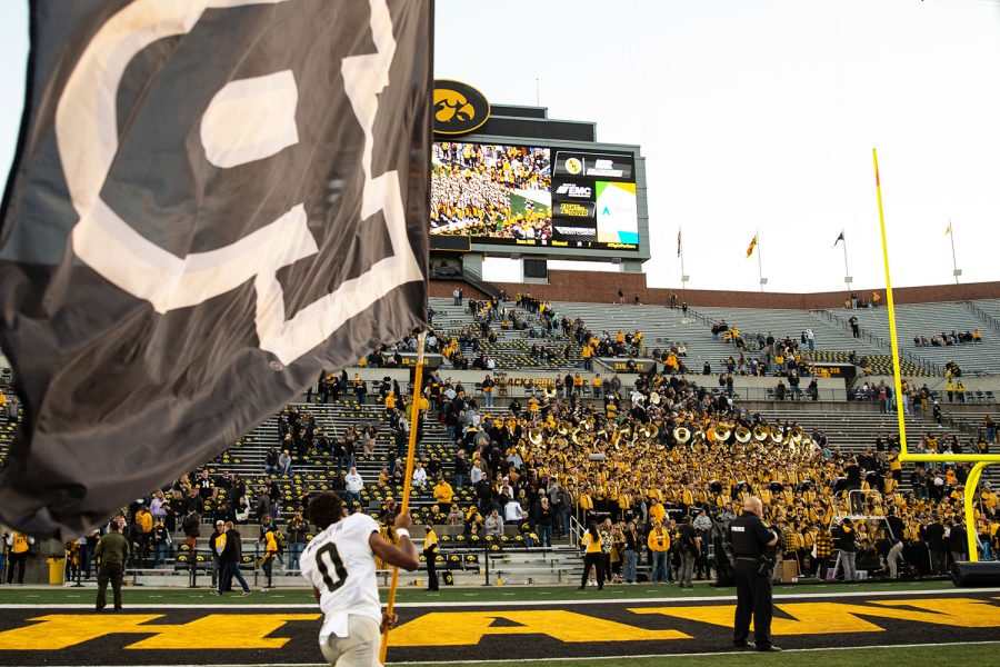 Purdue wide receiver waves a flag on Duke Slater Field after a football game between No. 2 Iowa and Purdue at Kinnick Stadium on Saturday, Oct. 16, 2021. The Boilermakers defeated the Hawkeyes 24-7.