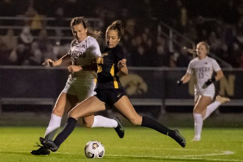 Iowa midfielder Kenzie Roling shoots and scores during a soccer game between Iowa and Minnesota at the UI Soccer Complex in Iowa City on Thursday, Oct. 21, 2021.The Hawkeyes defeated the Gophers 1-0.