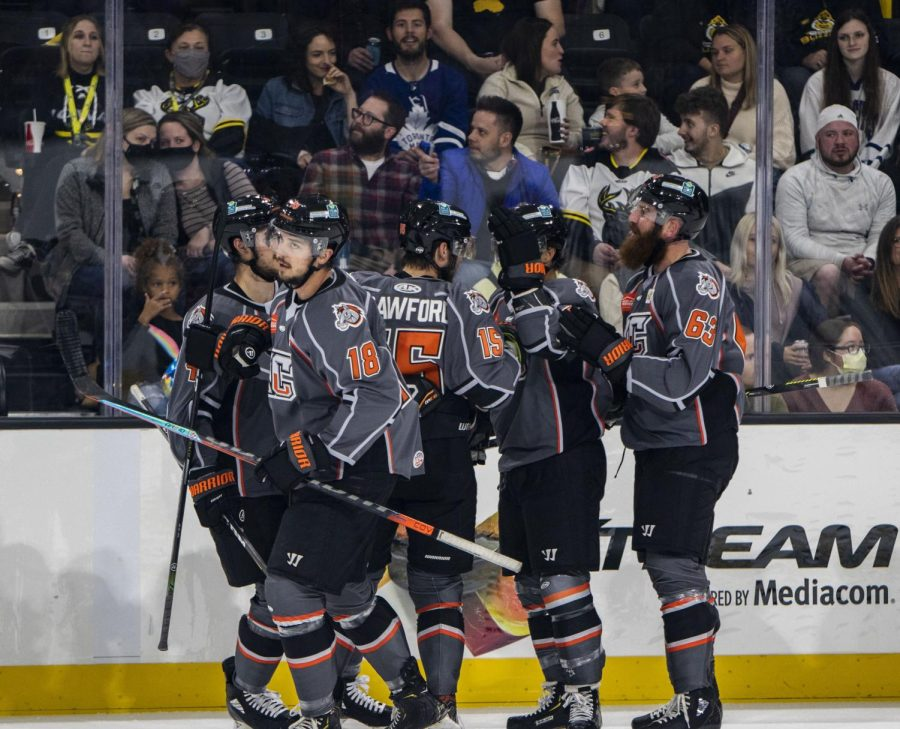 Fans look on at Kansas City Mavericks hockey players at Xtream Arena in Coralville, Iowa, on Oct. 22, 2021. The Mavericks lost to the Iowa Heartlanders, 7-4. The game was the first in Heartlanders history.